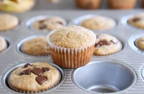the best banana muffins in muffin tin with one muffin sitting on top