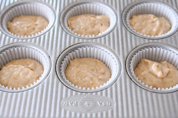 unbaked banana muffin batter in muffin liners