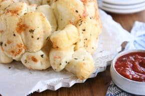 buttery garlic + herb pull-apart bubble bread with pieces on the side