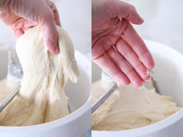 lifting dough out of bosch for the best homemade glazed donuts recipe