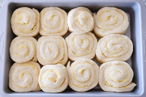 top down view of risen sweet rolls ready to bake