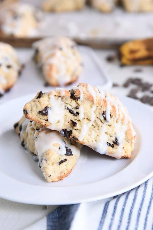 two baked and glazed scones on white plate