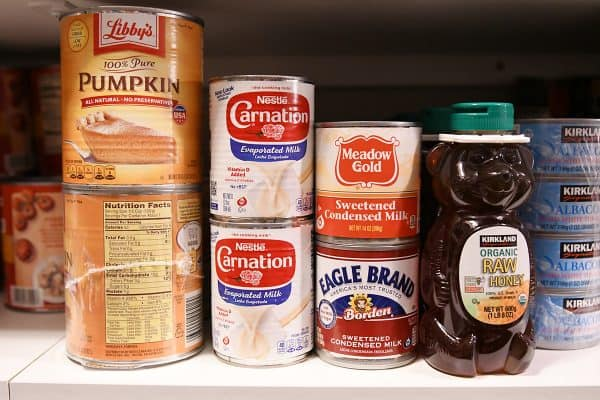 honey and canned goods on pantry shelves