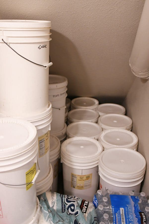 lots of 5 gallon buckets on floor of pantry