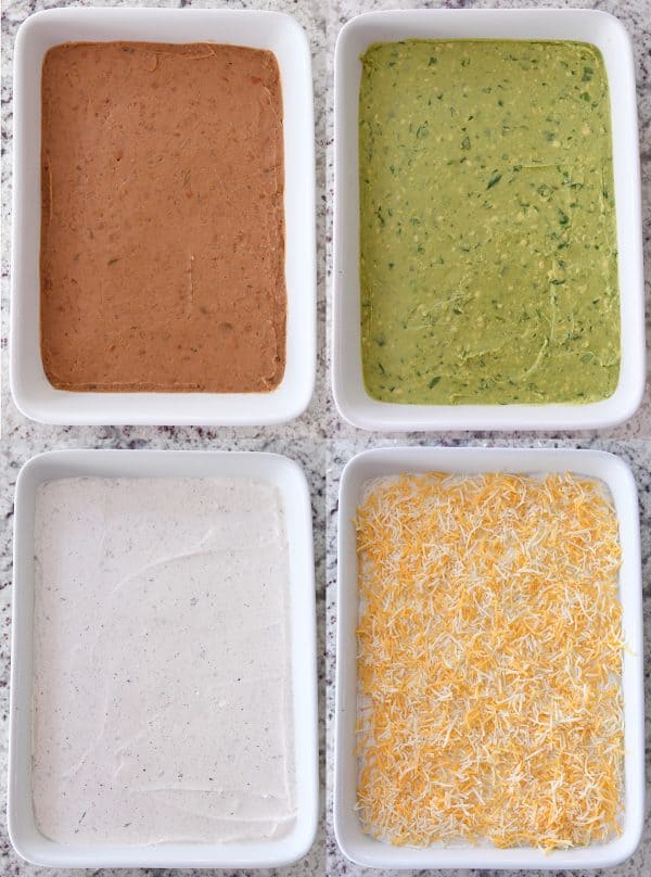 beans, guacamole, sour cream, and cheese layered in white dish for 7-layer dip