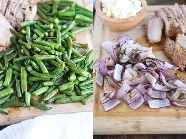 grilled green beans and grilled onions chopped on cutting board