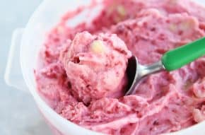 scooping out pink sorbet with ice cream sorbet