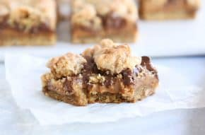 bite taken out of caramel peanut butter caramel bar