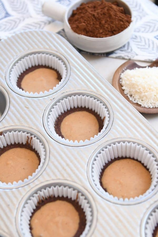 no-bake peanut butter cups in liners in muffin tin