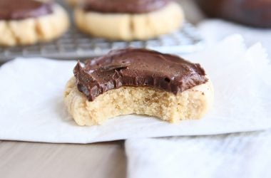 peanut butter sugar cookie with chocolate frosting on white napkin