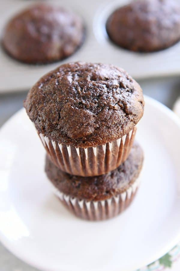 two double chocolate zucchini muffins stacked on each other