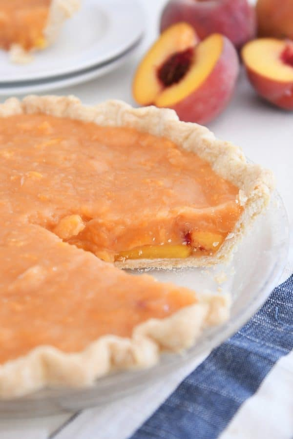 fresh peach pie with slice removed
