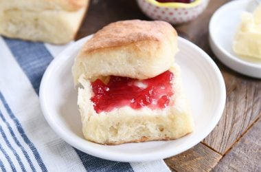 fluffy dinner roll cut in half and spread with butter and jam