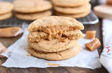 two brown butter caramel snickerdoodles stacked with one cookie broken in half on top