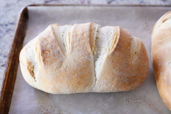 loaf of sourdough bread on sheet pan
