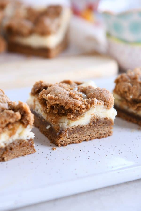 gingerbread cookie cheesecake bar on white speckled tray