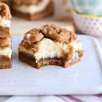 gingerbread cookie cheesecake bar with bite taken out on white tray