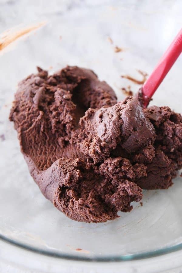 chocolate shortbread dough in glass bowl