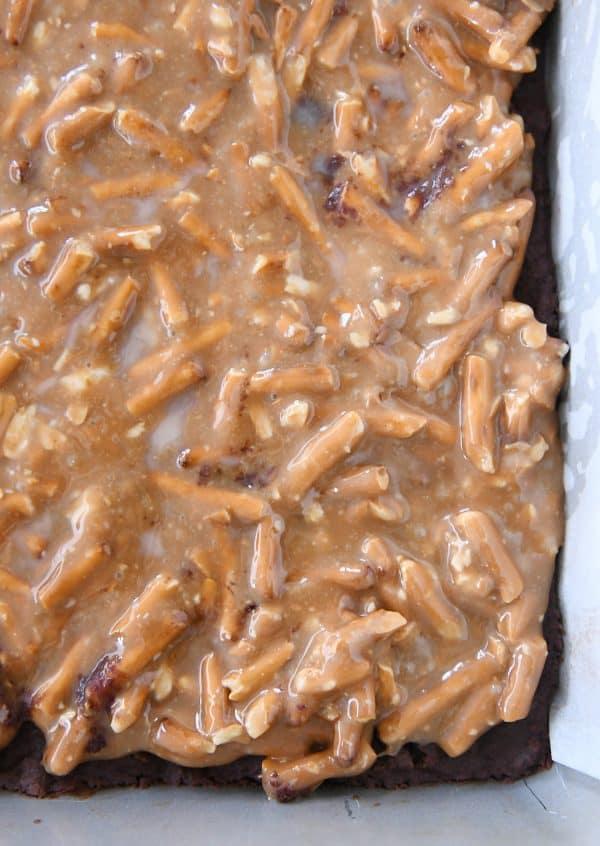 pretzel caramel on top of chocolate shortbread in 9X13-inch pan