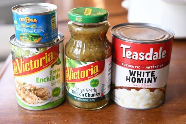 can of green enchilada sauce, can of green chiles, can of salsa verde thick and chunky, can of white hominy