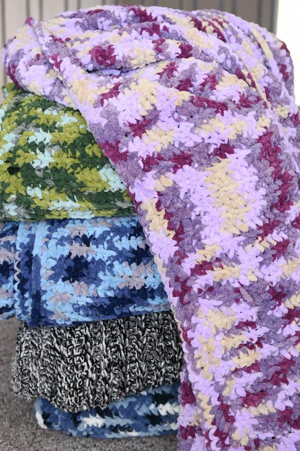 stack of crocheted blankets