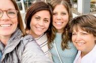 four women taking selfie