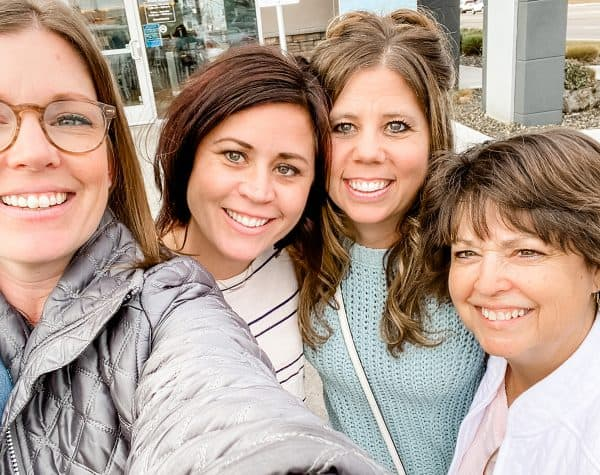 four women taking selfie