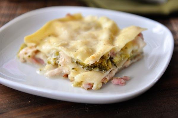 a square piece of chicken cordon bleu lasagna on a white plate
