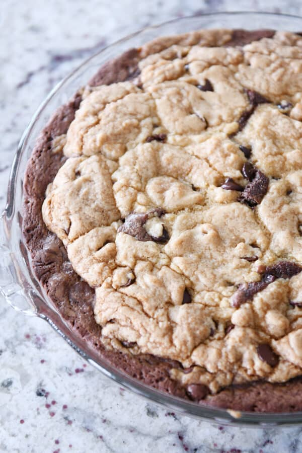 baked brookie pie in glass pie plate