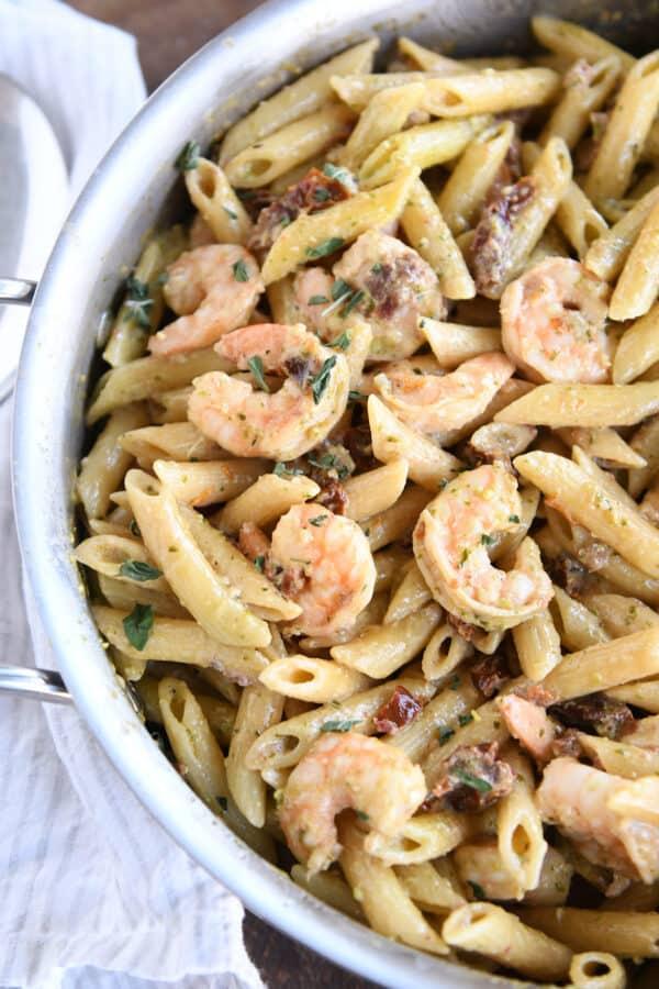 easy shrimp pesto pasta in skillet