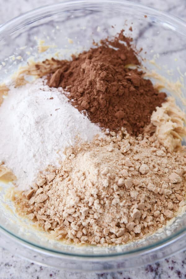 flour, cocoa powder, and graham cracker crumbs in glass bowl