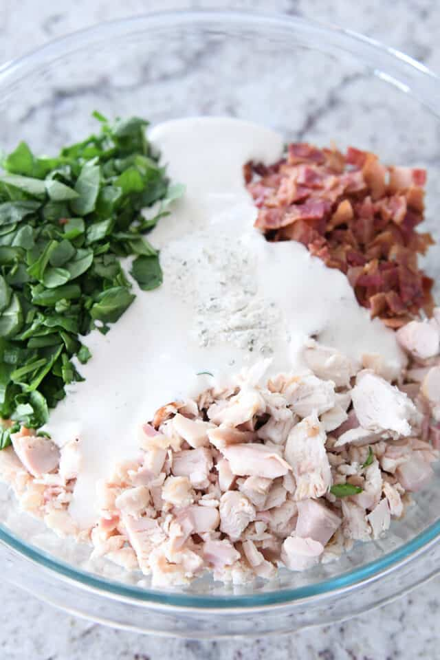 glass bowl with chicken, spinach, bacon, ranch dressing