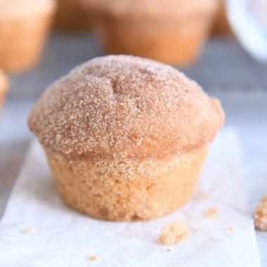 cinnamon sugar doughnut muffin on white napkin