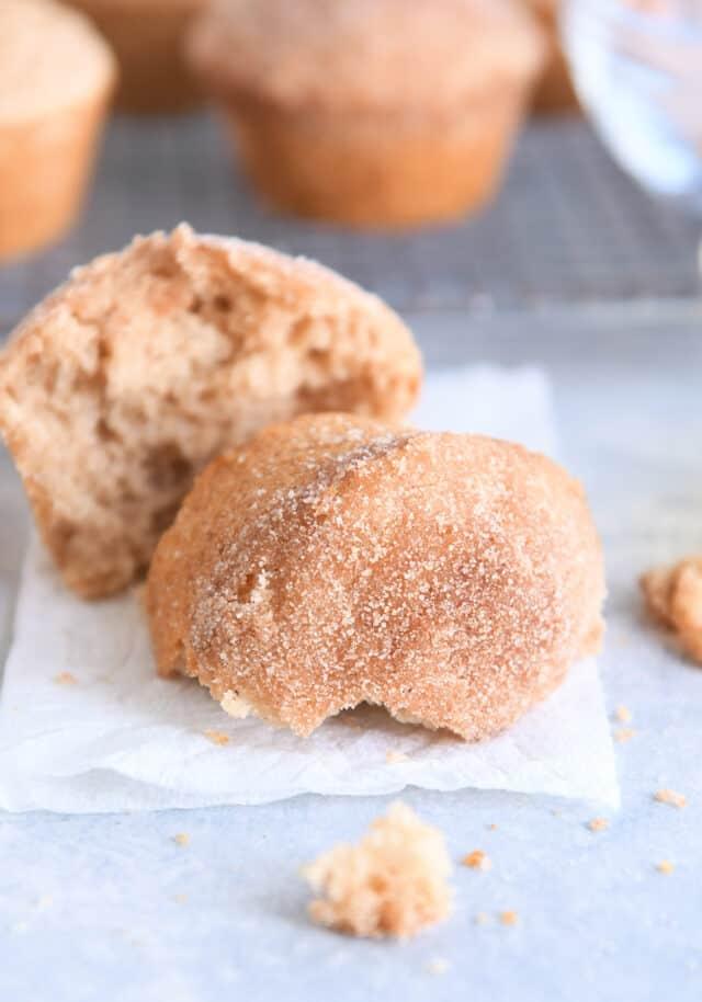 half of doughnut muffin on white napkin