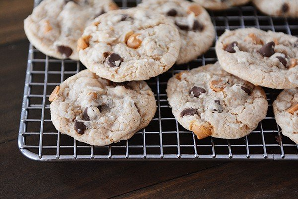 Chocolate and butterscotch chip cookies on a cooling rack.