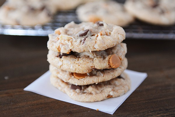 A stack of four chocolate and butterscotch chip cookies.