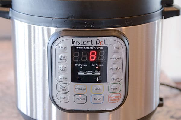 The front of an Instant Pot with 8 minutes left on the timer.