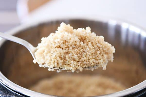 Spoonful of cooked quinoa in the Instant Pot.