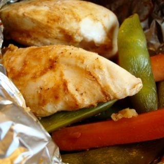 Foil Packet Chicken with Peas and Carrots