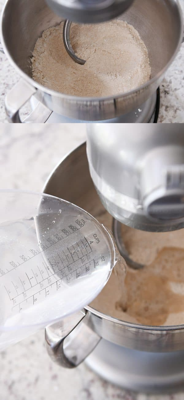 water and flour getting mixed with a dough hook in a metal KitchenAid bowl