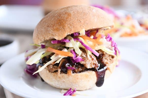 Honey balsamic BBQ pork sandwich on whole beat bun with coleslaw.