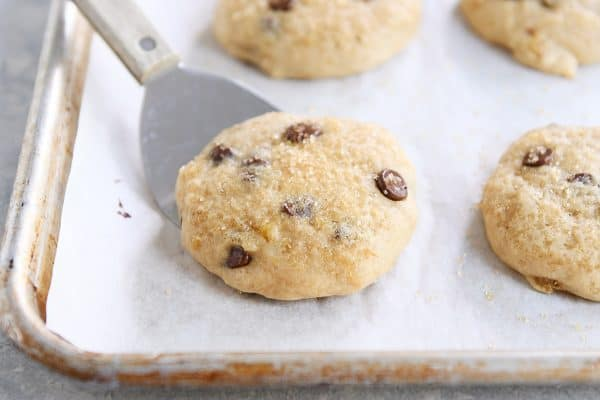 Soft banana bread cookie on baking pan with spatula.