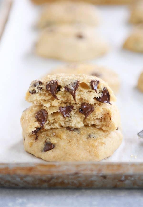 Soft banana bread cookie in half on baking sheet.