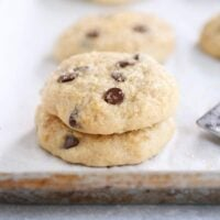 Stack of soft banana bread cookies on white napkin.