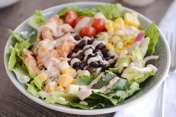 A BBQ chicken veggie and rice salad bowl.