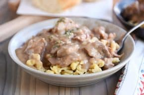 Bowl of slow cooker beef stroganoff over spaetzle.