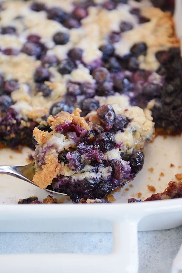 This tried-and-true, easy recipe for blueberry dump cake is made with a simple cake mix, fresh or frozen blueberries, butter, and milk. Minimal mixing!