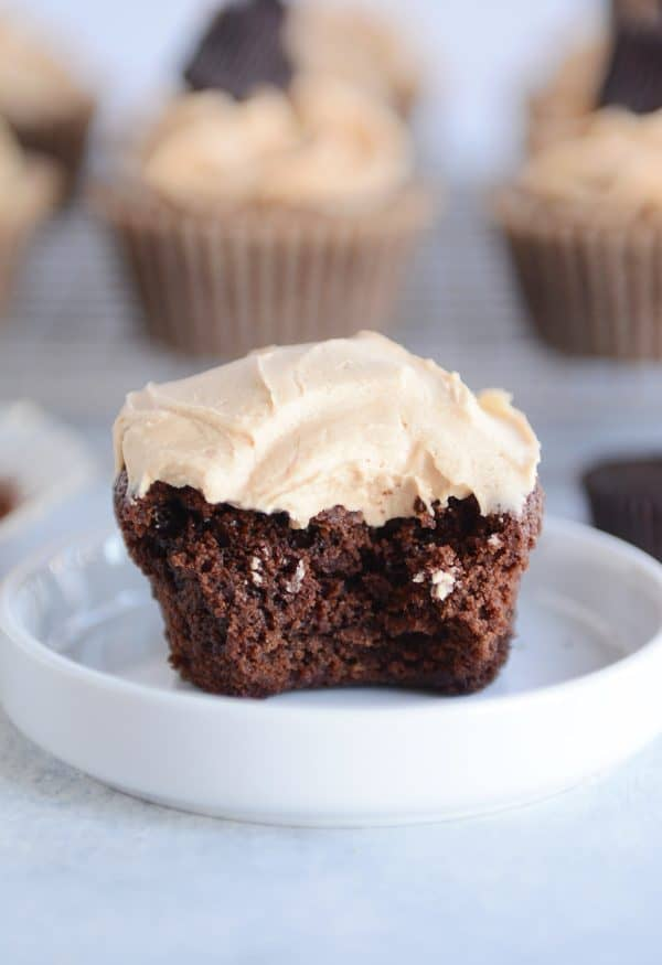 Fudgy brownie cupcake with the best peanut butter frosting with bite taken out.