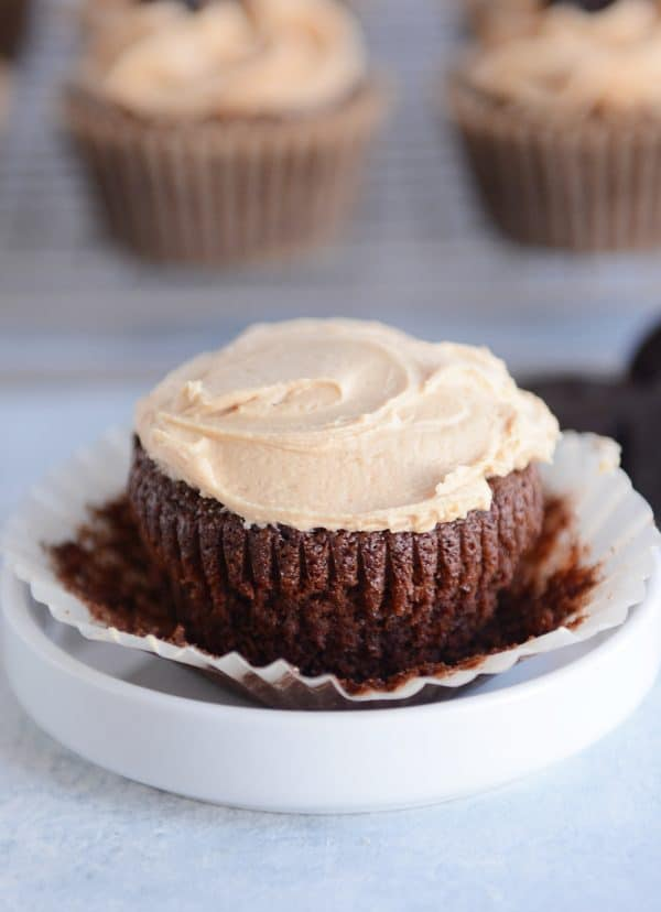 Fudgy brownie cupcake on cupcake liner topped with the best peanut butter frosting.