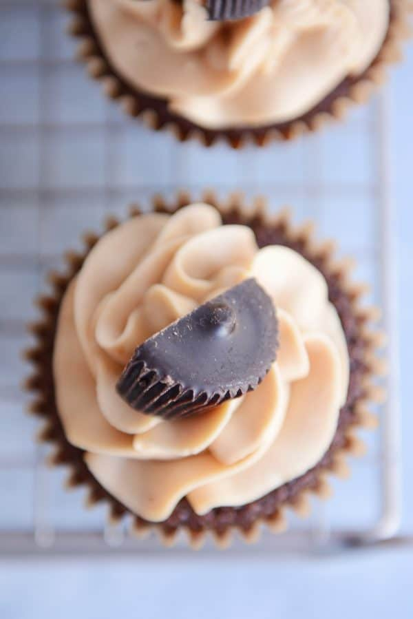 Top down view of a fudgy brownie cupcake with the best peanut butter frosting and half of a peanut butter cup.